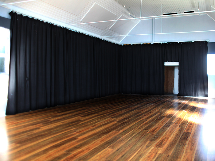 Black curtains hanging in venue