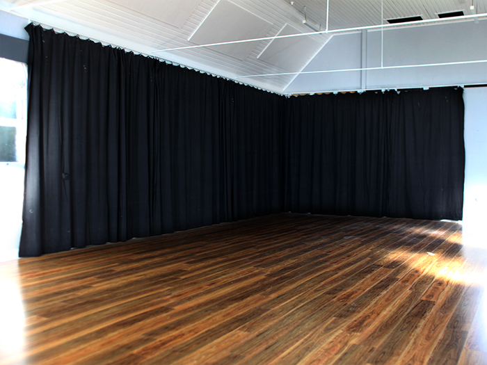 Black theatre curtains hanging in venue